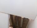 Фото Натяжной потолок в коридоре под лестницей